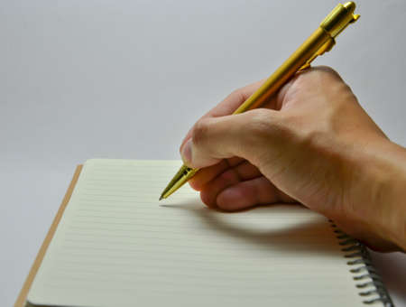 hand writing on notebook (pen, paper, notebook)