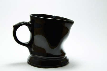 awry: Glass ceramic black shape design wrinkly on white background Stock Photo