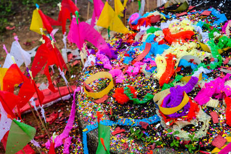 Wind with Colored papers placed on a grave during Qingming Festival at Songkhla Thailand.