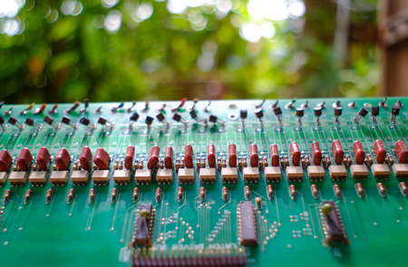 Against the background of old circuit boards naturally compatible.(blur background)