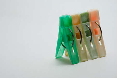 Sets color clothes-pegs over white background