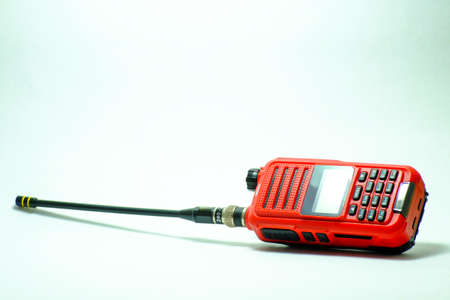 Used Portable UHF radio transceiver isolated on white background Stock Photo