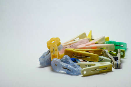 Colorful pegs old isolated on white background Stock Photo