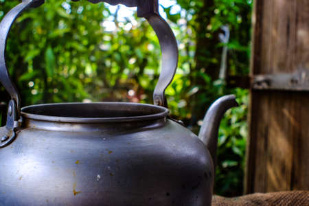 aluminium: Boiling silver kettle with a wood stove on background