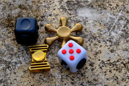 roller: Fidget Cube stress reliever, fingers toy on background, spinner(relax)