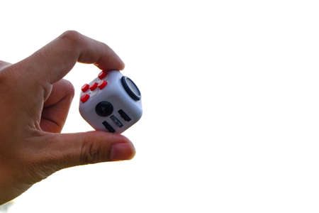 roller: Fidget Cube stress reliever, fingers toy on white background. (relax)