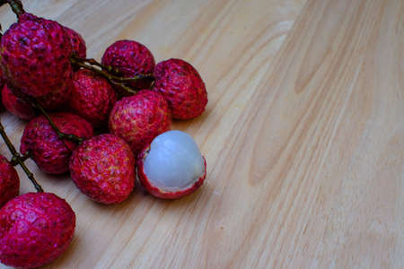 fresh lychees on wood table (lychee, litchi, fruit)