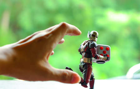 Songkhla, Thailand - July 19, 2017: ant man Fidget Cube running away from the mans hand. Editorial