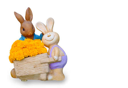 Rabbit statue holding a flower basket in white background