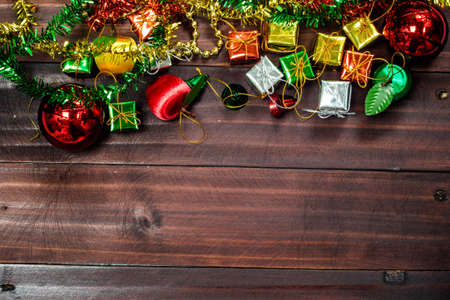 Old vintage Christmas decoration background arranged in opposing corners on rustic wood with copyspace Stock Photo