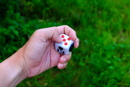 Fidget Cube stress reliever, fingers toy, white. (relax) Stock Photo