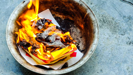 Chinese Offering Paper, Chinese traditional for burning pay respect to god or passed away ancestors spirits for Chinese ceremony. Stock Photo