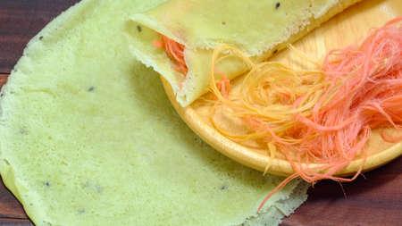 Thai cotton candy burrito pancake on wood background