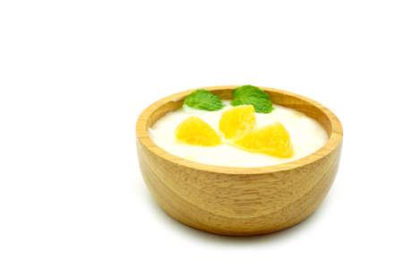 wood bowl of greek yogurt and fresh orange fruit and Mint leaves  isolated on white background