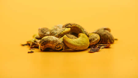 Cashews nut isolated on yellow background, cashew nuts salty roasted food ingredient natural.