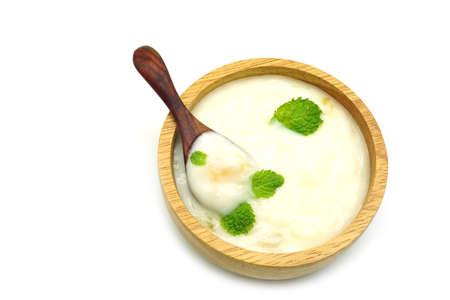 wood bowl of greek yogurt and fresh Mint leaves  isolated on white background Stok Fotoğraf