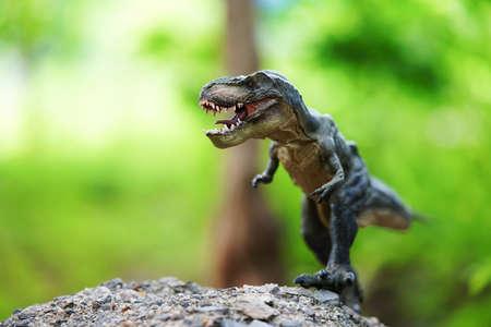 Tyrannosaurus rex dinosaurs running on nature background.