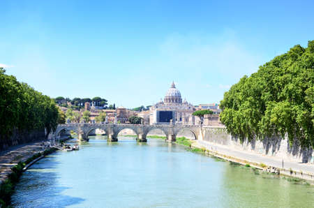 Vatican dome of San Pietro and Ponte SantAngelo, over Tiber river. Rome, Italy.
