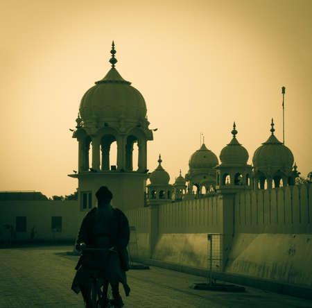 gurudwara: An old priest walking past Gurudwara (sikh temple) India Punjab