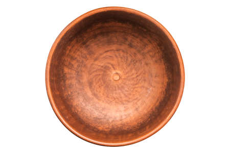 Clay bowl isolated on white. Closeup of a clay bowl, top view.