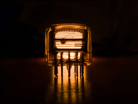 Old neon radio lamp is glowing in the dark