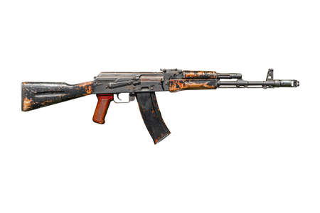 Old used AK 74 assault rifle isolated on white background.