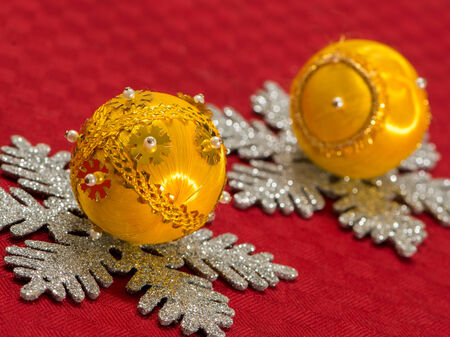 Yellow Christmas decoration balls on silver stars  photo