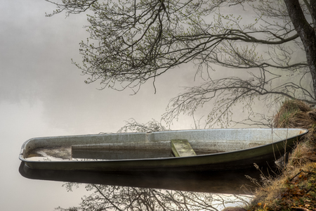 Boat on a lake shrouded in mist