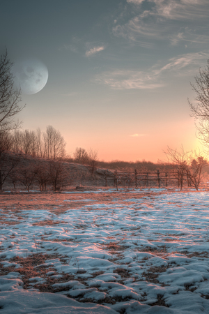 Morning moon and sunrise landscape from a cold spring morning  photo