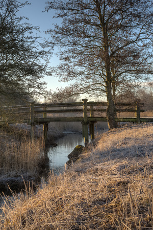 romatic: A small romatic bridge crosses a brook  Stock Photo