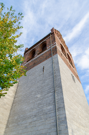 The tower of a small classic Danish church