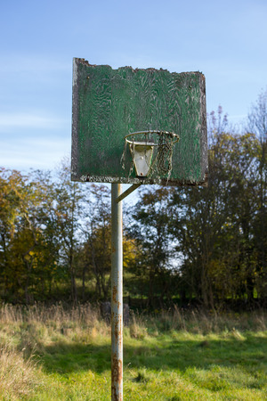 Old forgotten basketball hoop and net
