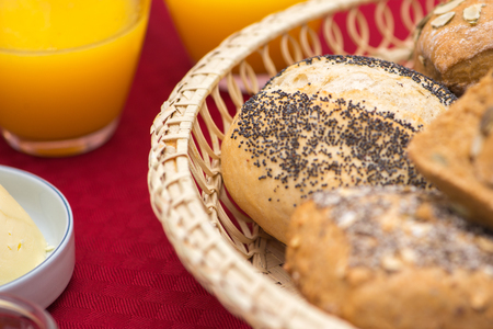 Closeup of bread and juice on red tablecloth
