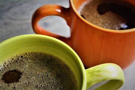 Two Mugs of American Coffee on Wooden Table