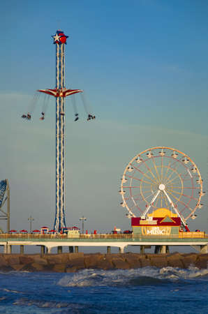 Galveston Pleasure Pier captured at dusk on a sunny day