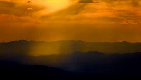 basin mountain: Shafts of light illuminate the Santa Fe Ski Basin in early autumn