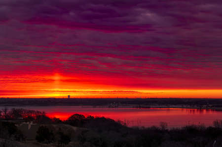 fort worth: Amazing crimson red sunrise over Benbrook Lake in Fort worth, TX