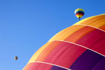 Colorful hot air balloons in flight over Napa Valley, California photo