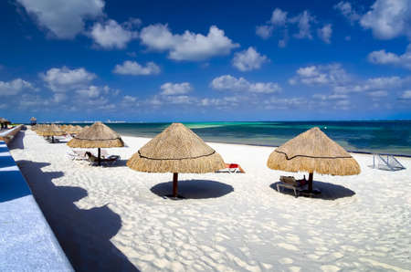 cancun: Tourists enjoying the  tropical ocean climate on the beach in Cancun, Mexico Stock Photo