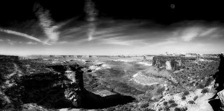 canyonland: Panoramic early morning view of the Grandview Point overlook in Canyonlands National Park with the moon visible Stock Photo