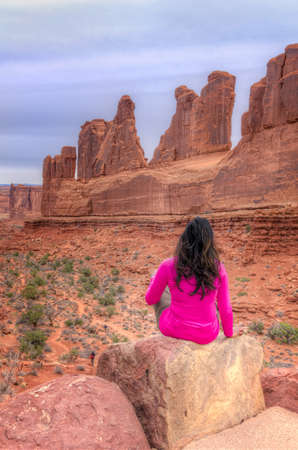 wilderness area: Yound Woman Admiring the Scenery in Arches National Park, Utah Stock Photo
