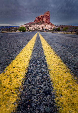 Road view towards a large monolith in Arches National Park, Utah photo