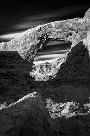 canyonland: Long exposure capture of the arched south window and cloud streaks in Arches National Park, Utah Stock Photo