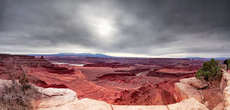 canyonland: Panoramic early morning view of Dead Horse Canyon  on a cloudy day Stock Photo