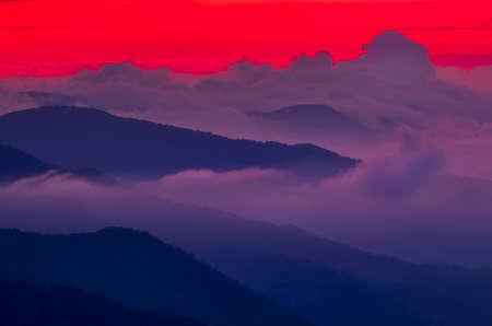 crimson: Breathtaking crimson sunset over cloud-covered Smoky Mountains in North Carolina
