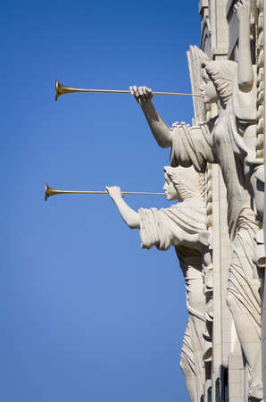 fort worth: Two angel sculptures with trumpet horns on the front facade of the Bass Performance Hall Stock Photo