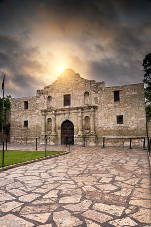 texas state flag: Ominous sky hovering over the historic Alamo in San Antonio, TX