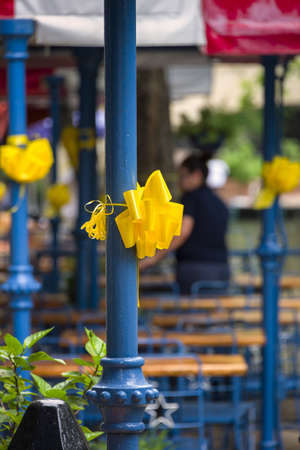 yellow ribbons decorating blue columns at an outdoor cafe stock photo picture and royalty free image image 19719207 - Blue Cafe Decorating