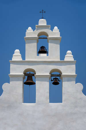church bells: Historic mission made of adobe covered with stucco Stock Photo