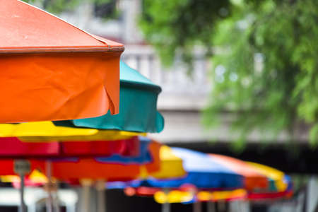 antonio: Colorful umbrella canopies at a riverside cafe in Texas